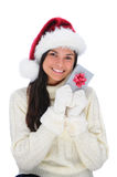Young Woman holding Christmas Present to face Royalty Free Stock Images