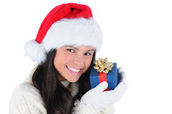 Young Woman holding Christmas Presents to face Stock Photos