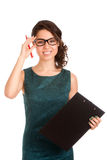 Young woman holding clipboard Royalty Free Stock Photography