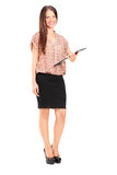 Young woman holding a clipboard Royalty Free Stock Photo