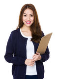 Young woman holding with clipboard Royalty Free Stock Photo