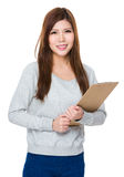 Young woman holding clipboard Stock Photos