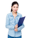 Young woman holding with clipboard Stock Photos