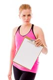 Young woman holding a clipboard and staring toward camera Stock Image
