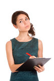 Young woman holding clipboard and thinking Stock Images