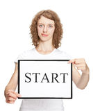 Young woman holding clipboard with word START Royalty Free Stock Photography