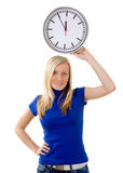 Young woman holding clock Stock Image