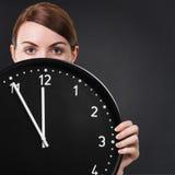 Young woman holding a clock Stock Photos