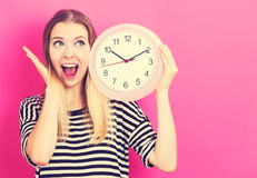 Young woman holding a clock Stock Image