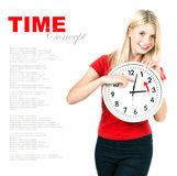 Young woman holding a clock. Time management concept royalty free stock images
