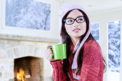 Young woman holding a coffee cup Stock Photo
