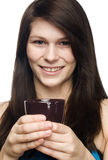 Young woman holding coffee cup and smiling Royalty Free Stock Photography