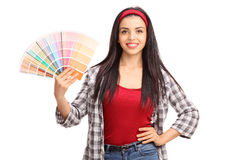 Young woman holding a color swatch Stock Images