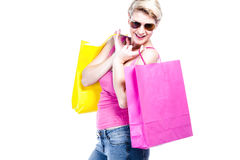 Young woman holding colored shopping bags Stock Photography