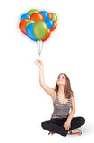 Young woman holding colorful balloons Stock Photos
