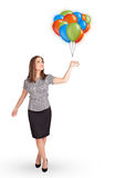Young woman holding colorful balloons Royalty Free Stock Photos