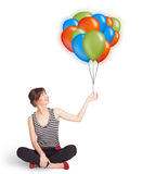 Young woman holding colorful balloons Stock Photography