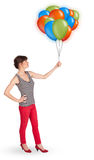 Young woman holding colorful balloons Royalty Free Stock Image