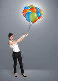 Young woman holding colorful balloons Royalty Free Stock Photo