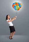 Young woman holding colorful balloons Royalty Free Stock Images