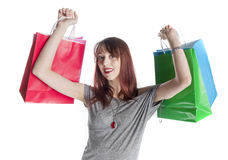 Young Woman Holding Colorful Shopping Bags Stock Photo