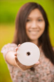 Young woman holding compact-disk Royalty Free Stock Photo