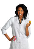 Young Woman Holding Container with Pills. Portrait of beautiful African American doctor or nurse holding prescription drugs isolated over white background Stock Image