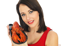 Young Woman Holding a Cooked Lobster Royalty Free Stock Image
