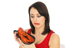 Young Woman Holding a Cooked Lobster Stock Photos