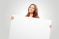 Young woman holding copy space Royalty Free Stock Image