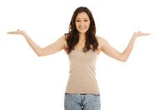 Young woman holding copy space in hands. Stock Photos