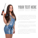 Young woman holding a cordless electric drill Royalty Free Stock Images