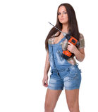Young woman holding a cordless electric drill Stock Photography