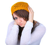 Young woman holding covering her ears Royalty Free Stock Photography