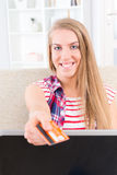 Young woman holding credit card Stock Photos