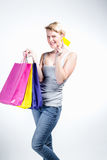 Young woman holding  credit card and bags Stock Photography