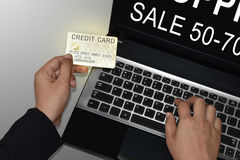 Young woman holding credit card on laptop for online shopping concept.  Stock Image