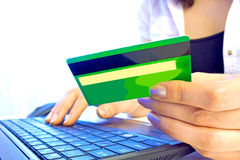 Credit card. Young woman holding credit card on laptop for online shopping, photography Royalty Free Stock Photos
