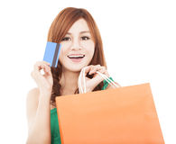 Young woman holding credit card with shopping bag. Smiling young woman holding credit card with shopping bag Stock Photos