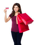Young woman holding credit card and shopping bag Stock Images