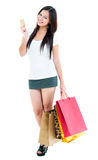Young Woman Holding Credit Card And Shopping Bags Stock Photo