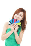 Young woman holding credit cards. Happy young woman holding credit cards Royalty Free Stock Photo