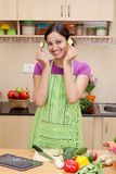Young woman holding cucumber slices Royalty Free Stock Photo