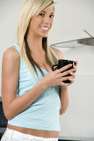Young woman holding cup Stock Images