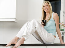 Young woman holding cup Royalty Free Stock Photo
