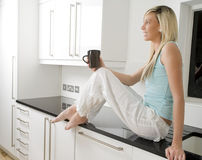 Young woman holding cup Stock Image