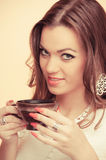 Young woman holding cup of coffee Stock Photography