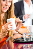 Young woman holding cup of coffee in hand Royalty Free Stock Photo