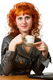 Young woman holding a cup of coffee Stock Photography