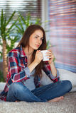 Young woman holding a cup Royalty Free Stock Photos